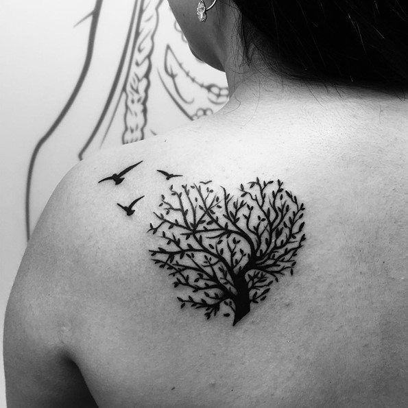 tree tattoo with bird on back                                                                                                                                                                                 More