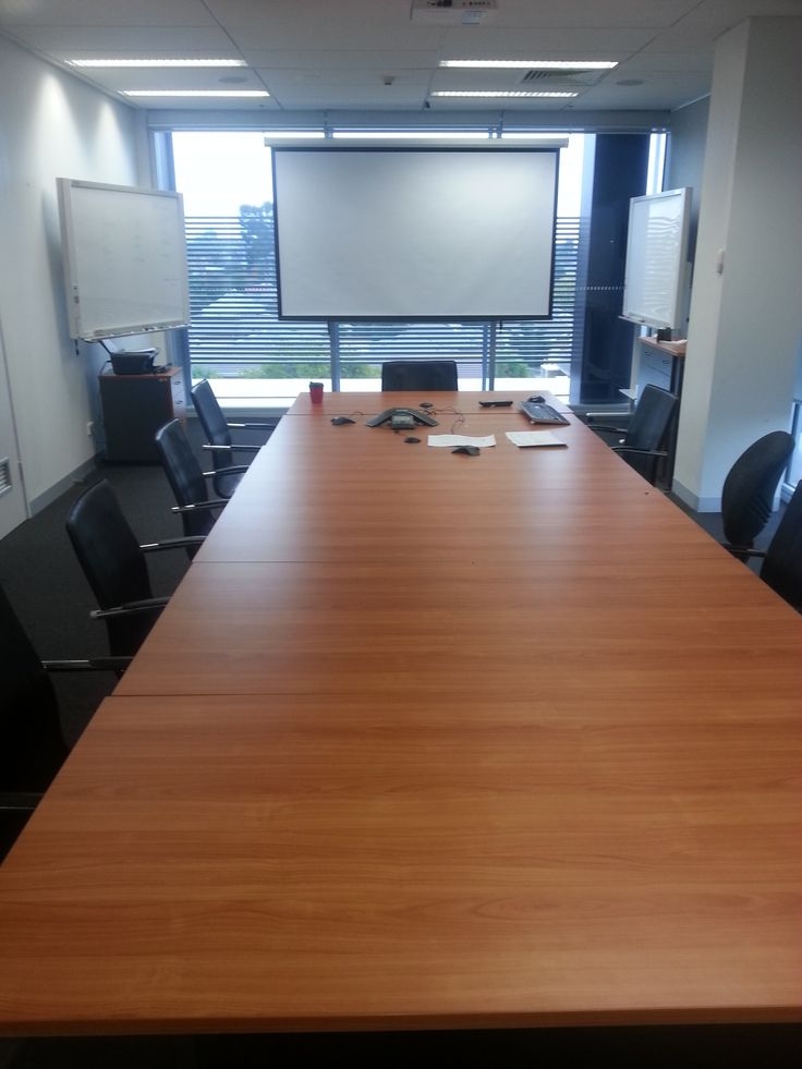 "A large Boardroom and Training area installed and designed by the team @ Macktronix. This room features a 110"" Motorised Retractable Screen, Articulating Whiteboard with Print feature, Flush Mounted Speaker system, Roof mounted HD Webcam, Dedicated video conferencing hardware and much much more!"