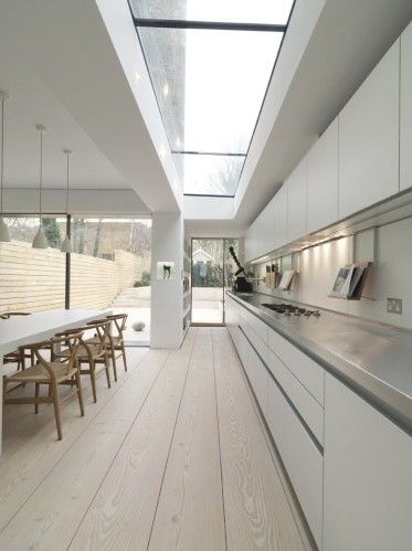 Stunning linear kitchen extension. CLICK http://www.hollandgreen.co.uk/house_extensions#.U_L9sPldU7k to find out how you could have your dream kitchen extension.