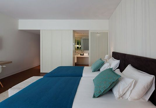 Modern, eco-friendly four-star hotel in Lisbon including a Deluxe room, breakfast and spa privileges