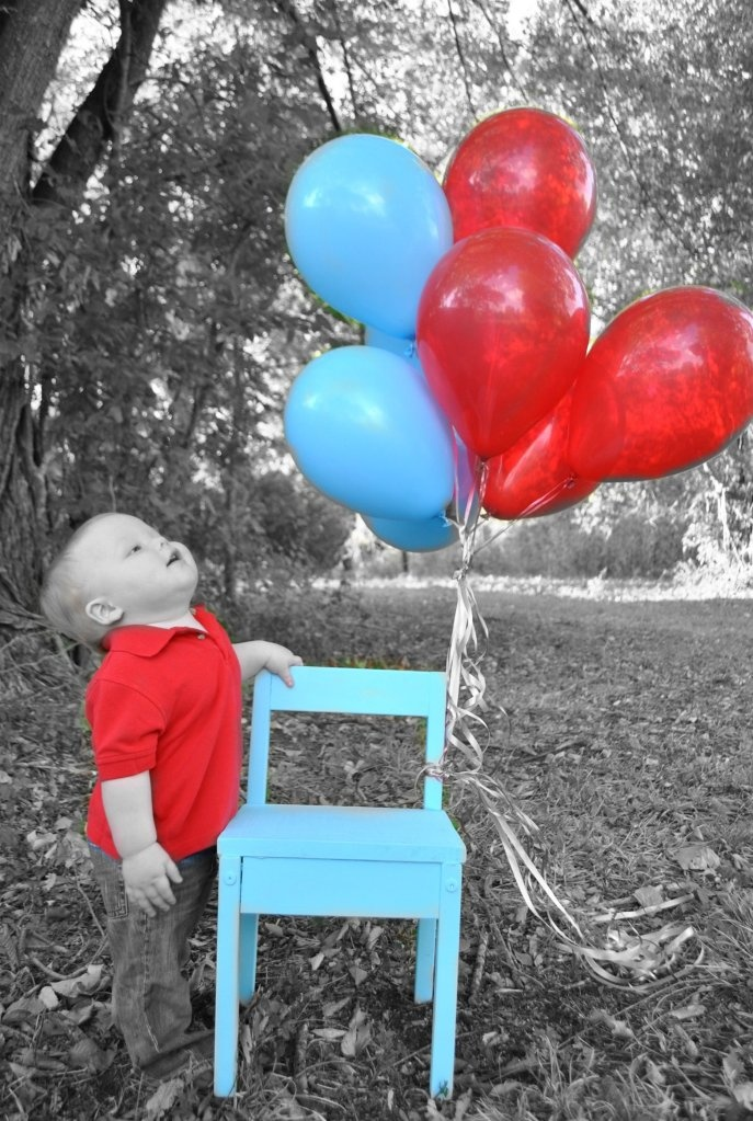 First birthday picture... would have been cute if Aden's balloons had not blown away!