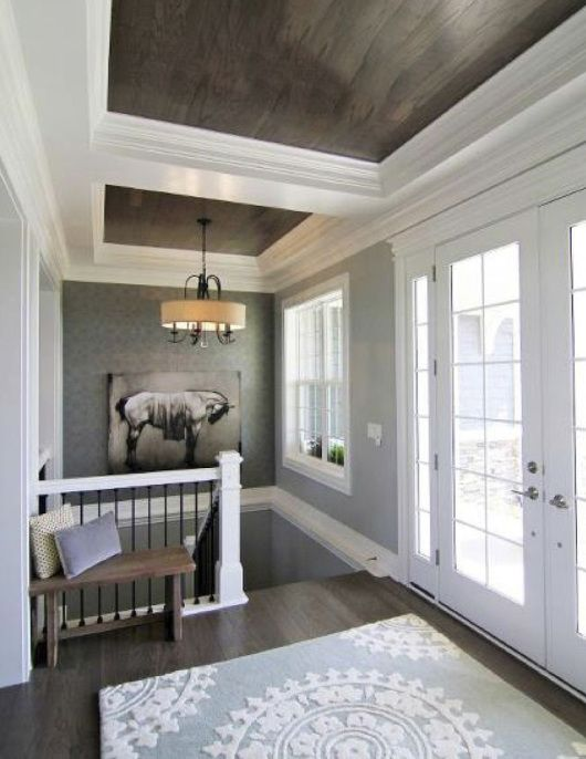 Love these wood ceilings trimmed with white