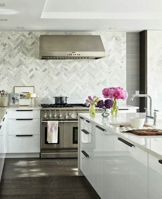 Dramatic Herringbone Patterned Marble Tile Backsplash In This Kitchen By Croma Express