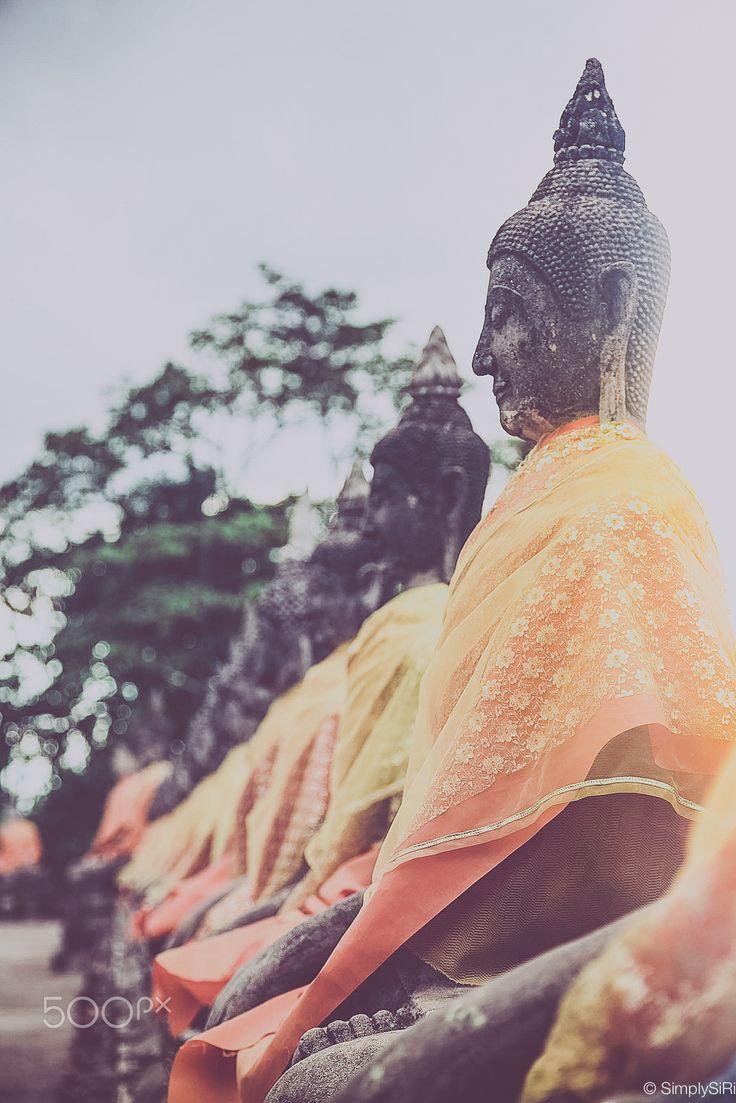 Vintage escape - Buddha statues at Wat Yai Chaimongkol, Ayutthaya, Thailand.