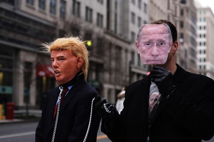 Two attendees of the inauguration parade troll Trump supporters waiting in line to clear security. #inauguration #politics #nurphoto