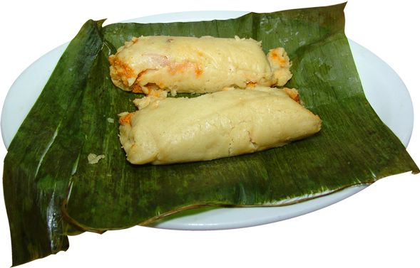 Tamales de Pollo.  Corn tamales stuffed with chicken and vegetables.  Steamed in a banana leaf.
