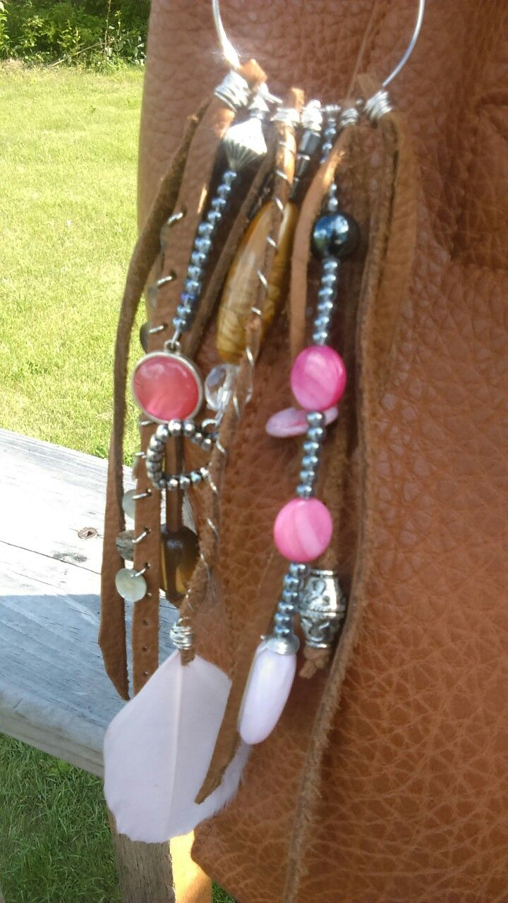 Purse Tassel made with Buffalo hide and Upcycled jewelry pieces