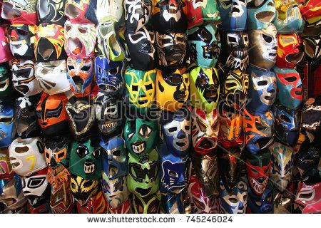 """A selection of colorful """"Lucha Libre"""" Mexican professional wrestling masks, for sale outside of Arena Mexico, Mexico City"""