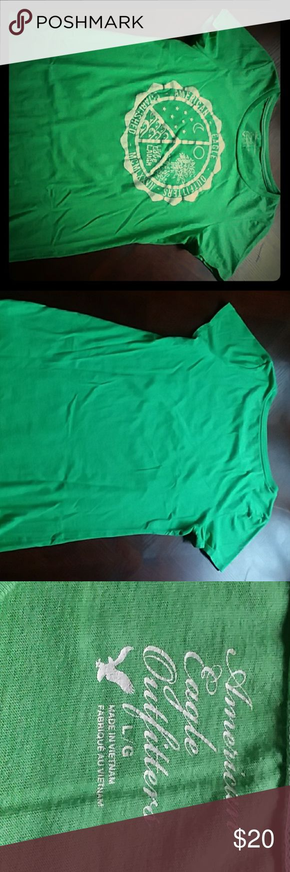 "American Eagle Outfitters Green T-Shirt Size L American Eagle Outfitters green t-shirt with design on the front size L. Like new condition. Verified Measurements are 25"" length and 17"" across the chest. Shirt has been washed and is ready to ship! American Eagle Outfitters Tops Tees - Short Sleeve"