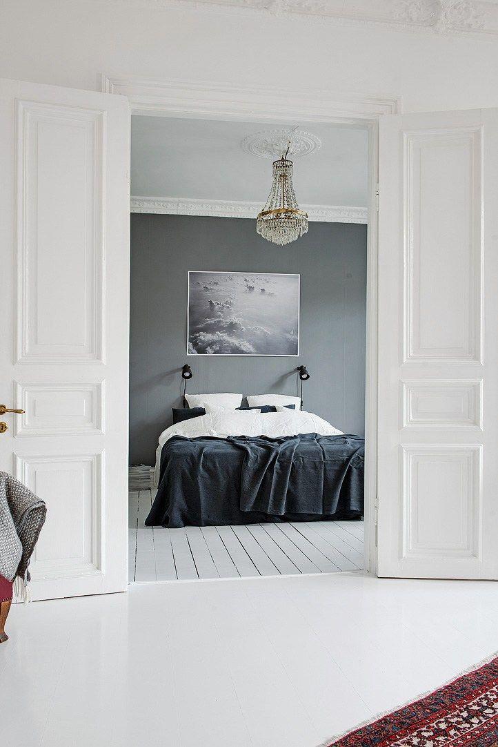 Statement art over neutral bedroom
