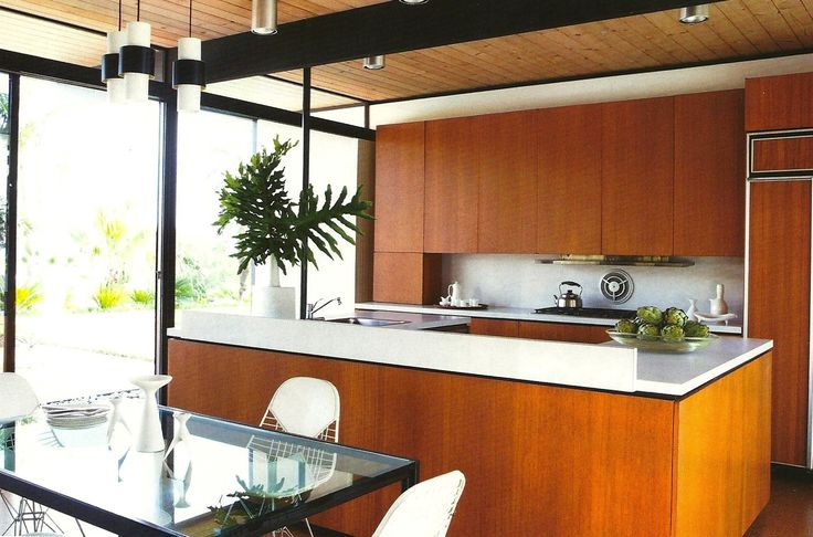 wood paneling on ceiling, black beams, black window framing, wood cabinets, white countertops