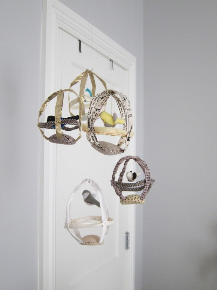 I like this mobile, it's made out of news paper from the look of it :P http://projectnursery.com/projects/our-nursery-lounge/