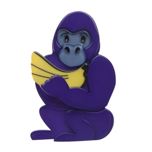 """Limited Edition Giggles the Gorilla Brooch in purple. """"You see that smile on across Giggles' face? Possibly not it is partially hidden by a rather large bunch of bananas. Funnily enough those bananas are the very reason Giggles is smiling. In fact the only thing Giggles enjoys more than a large bunch of bananas is a broad smile and a hearty laugh."""""""