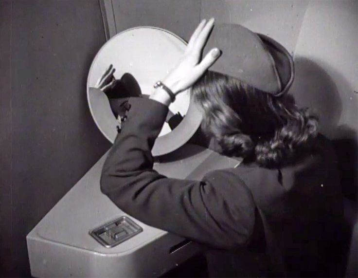 A KLM stewardess, preparing herself for a working day in a DC-6 (1948). CC-BY-SA Open Beelden