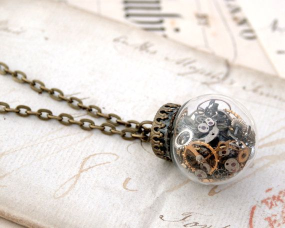 Glass Globe Pendant Necklace  Make a steampunk statement with this lovely and unusual necklace.  The wheels, barrels, cogs, windups and other