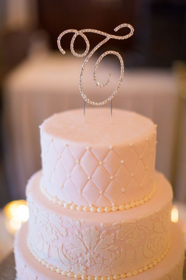 A pale pink wedding cake with a quilted pattern. Photo by Tami Melissa Photography