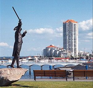 Harbour waterfront, Nanaimo. Showing statue of Frank Ney, largest supporter and promoter of the Nanaimo World Bathtub Races. Also depicting Cameron Island condos.