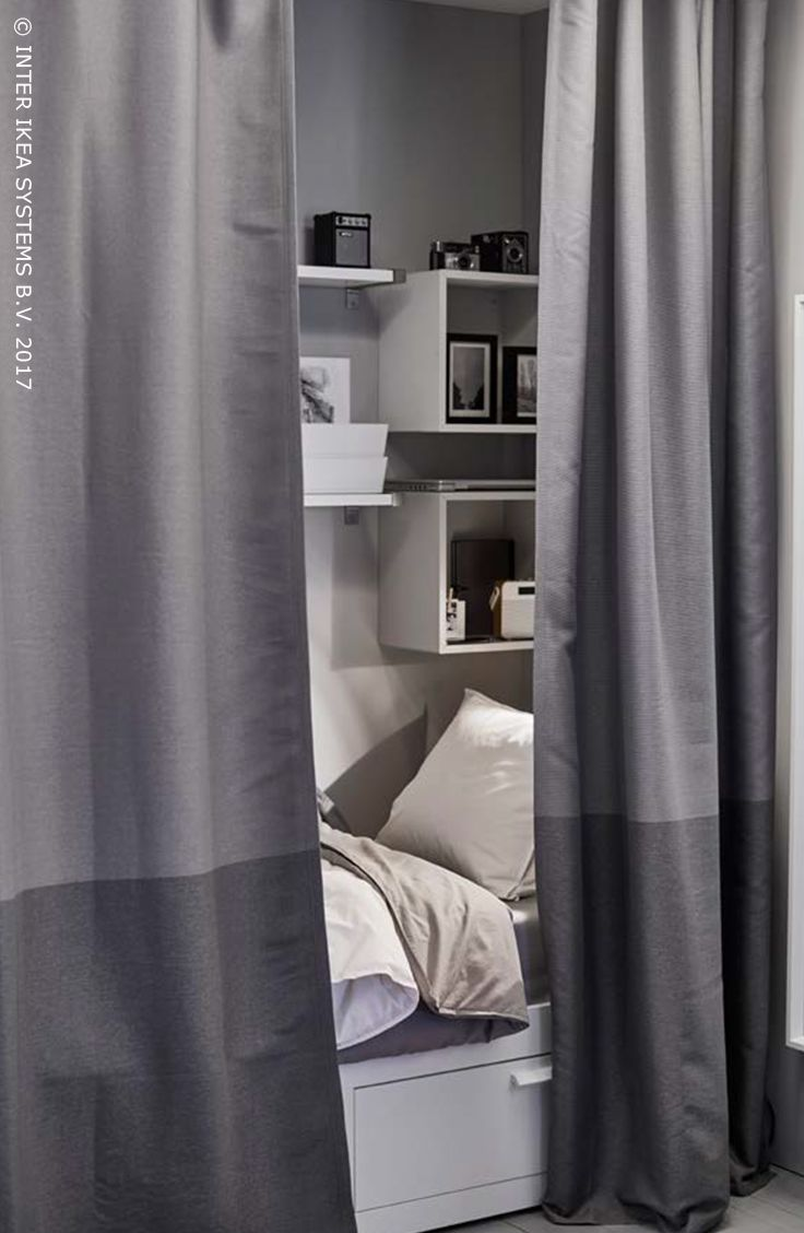 Black ombre curtains - A Small Sleeping Space Gets Extra Privacy With Curtains That Work As A Room Divider