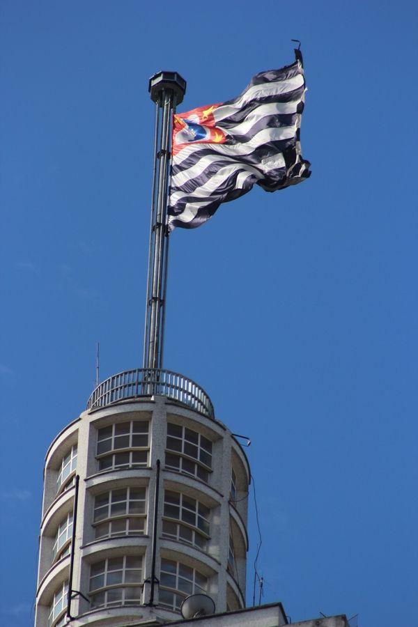 The flag of São Paulo state flutters on top of Banespa building (Edifício Altino Arantes). São Paulo, Brazil