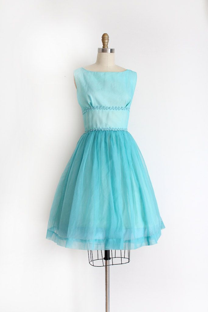 Adorable little blue chiffon prom dress from the late 1950s / early 1960s. This dress features a fitted waistline, little lace trim, and a semi