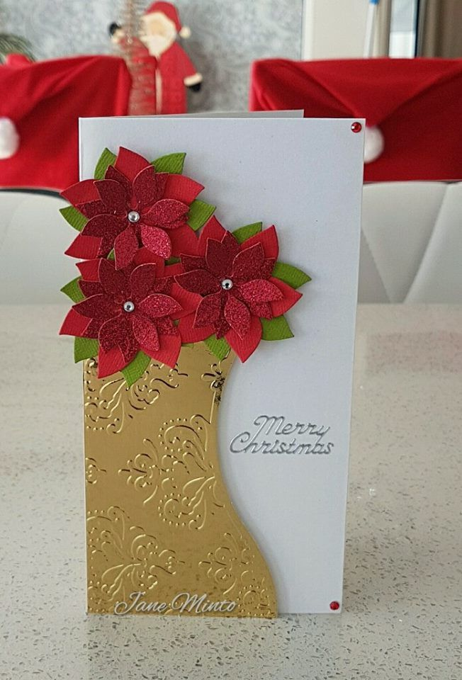 A Christmas card made using 'that folder'. I made a card like this before by making a mistake with the card and turning it into a vase, so thought I would do a Christmas version too.