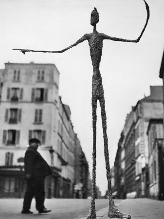 Skeletal Giacometti Sculpture on Parisian Street - Photographie de Gordon Parks