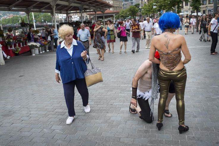 A woman walks past participants at a gay pride march in Bilbao, northern Spain June 28, 2015. REUTERS/Vincent West