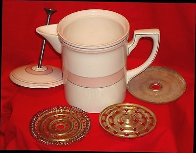 """RARE-Booths-Tunstall-England-porcelain-coffee-plunger-press-melior-1934 The bottom reads ½ pint so it is single serve. Britain patent no GB448883 traces back to an  """"Improved filter for filtering coffee or other infusions or liquids."""" Priority date 1934-03-02; Publication info: 1936-06-07. Apparatus in which ground coffee or tea-leaves are immersed in the hot liquid in the beverage; having immersible, e.g. rotatable, filters."""