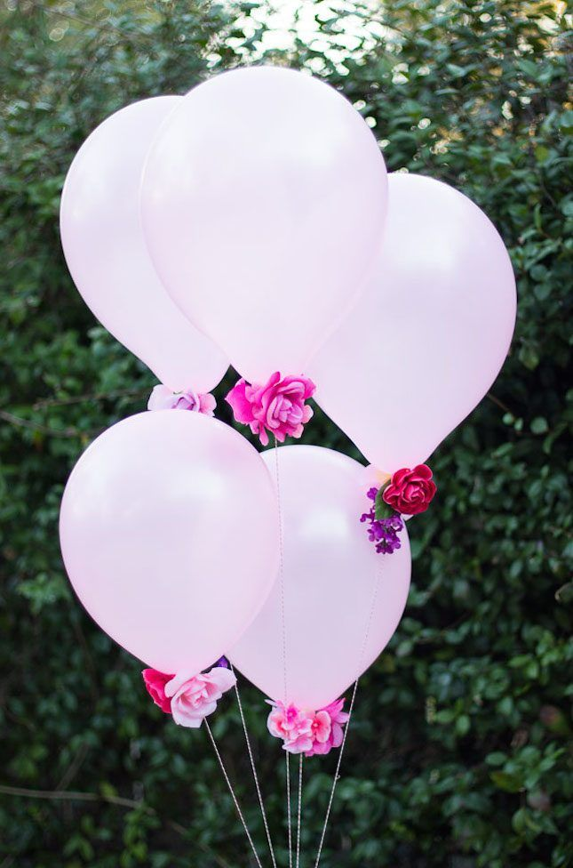 As fun and festive as balloons already are, there's nothing like adding faux florals to them to really spruce things up.