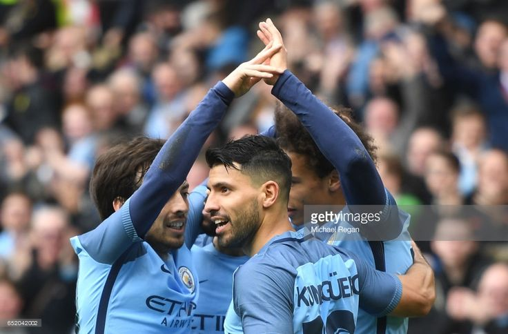 Sergio Aguero of Manchester City (R) celebrates scoring his sides second goal with his Manchester City team mates during The Emirates FA Cup Quarter-Final match between Middlesbrough and Manchester City at Riverside Stadium on March 11, 2017 in Middlesbrough, England.