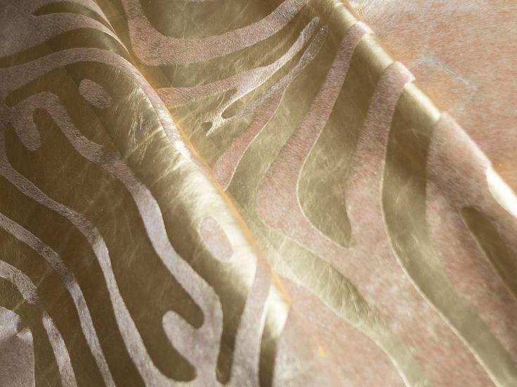 Gold on beige zebra cowhide rug https://hugohides.com/cowhide-rugs/Metallic-Cowhide-Rug