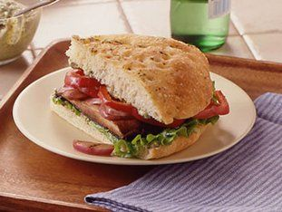 Grilled Portabella and Bell Pepper Sandwiches Recipe: Grilled vegetables boost the flavor of these irresistible Italian sandwiches. In just 30 minutes, you'll be taking a big bite!