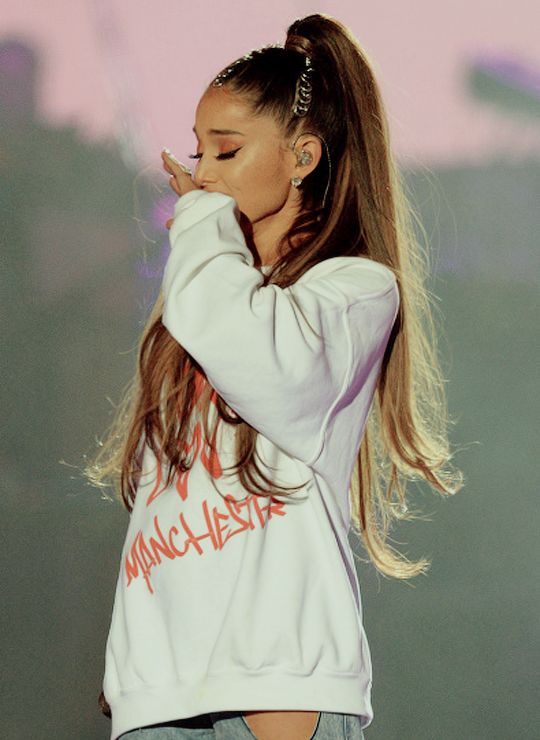 Ariana Grande getting emotional on stage