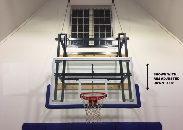 SuperMount46 Triumph wall mounted basketball goal with FT310 Backboard Height Adjuster manufactured by First Team Sports.