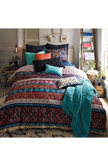 Inspired by the colorful, hand-painted tiles of Mexico City, a bright pattern and patina-textured appearance enliven a dreamy bedding.