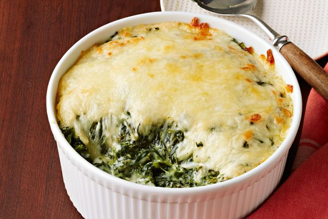 Discover a crowd-pleasing dish with this Creamed Spinach Alfredo Casserole. Check out this simple holiday recipe which requires only 4 ingredients!