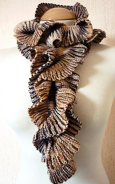Helix Scarf by Stephenie Gaustad  Made several of these...fun fun fun to make.......This Pattern is good for almost every kind of yarn....It really shows you all if them I believe there is 24 different fibers via Sandy who is a pro!