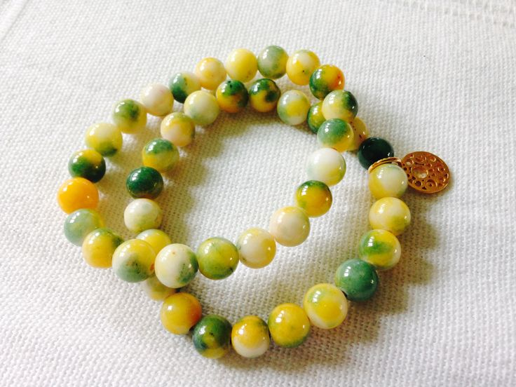 Chios jewelry, bracelet with golden charm. Yellow and green. Jadeite bracelet.