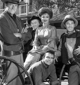 Gunsmoke!  Marshal Dillon (James Arness), Doc Adams (Milburn Stone), Kitty Russel (Amanda Blake), Quint Asper (Burt Reynolds), and Festus Haggen (Ken Curtis).