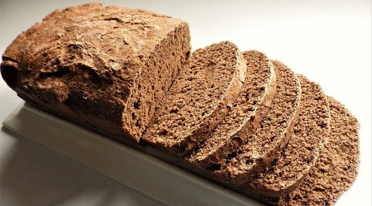Pumpernickel Bread is a dense and moist rye bread made with coarse rye-flour. It has a dark color and was a traditional German bread served in the Fall and during the holidays. We're going to vary this recipe a bit using 3 types of flour but rye is in the mix. This bread was often started with a sourdough yeast, but that's complicated so we're going to add some lemon juice to give it the tartness and sour taste of sourdough. This is a hearty bread and goes great with meaty meals, gravies and