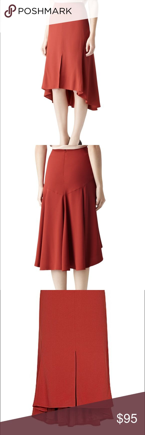 Chic Paprika Fit + Flare Stephanie Skirt Reiss fit and flare skirt. The Stephanie in an autumnal shade of paprika, a modern take on a fit and flare shape. This fluid style with body-shaping panels, has a centre slit to the front and a dipped back with a flippy flared hem. It secures to the back with a concealed zip. A favorite label of Catherine, Duchess of Cambridge. Viscose and acetate blend. Excellent, like-new condition--worn once! UK Size 10. Offers welcome within reason. Reiss Skirts