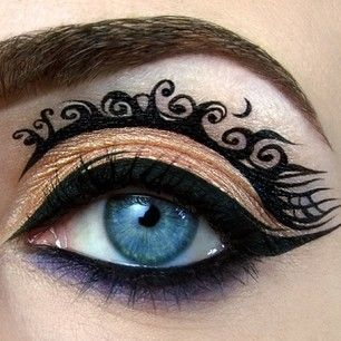 This golden-purple eye with intricate flourishes. | 16 Crazy-Awesome Examples Of Eyeshadow Art