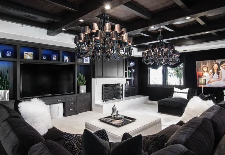 Gorgeous black n white multi media family room with exposed beams, beautiful dual chandeliers and a huge black velveteen sectional.