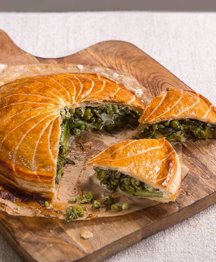 With overlapping layers of soft, caramelised leeks and asparagus, and creamy peas and mascarpone, this vegetarian pie recipe is the perfect way to celebrate vibrant spring vegetables. Danny Kingston encloses his veggie pie in layers of golden, flaky Jus-Rol puff pastry, shaped in a glorious dome, similar to a classic pithivier.