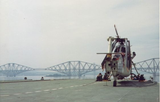 Sikorsky S-58 helicopter parked on the front of Karel Doorman near the Forth Bridge at Rosyth in June 1967. Photo provided by Rob Becker.