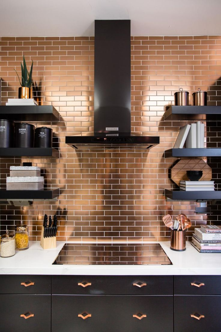 A graphic black and white tile floor, a waterfall quartz topped island and a stunning copper subway tile backsplash give this open kitchen serious style, while smart technology helps make cooking and daily activities easier.