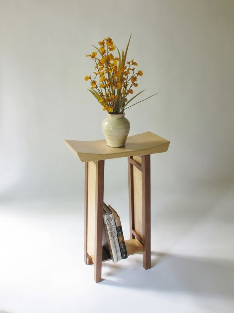 narrow modern zen side table with a handshaped artistic table top and the low