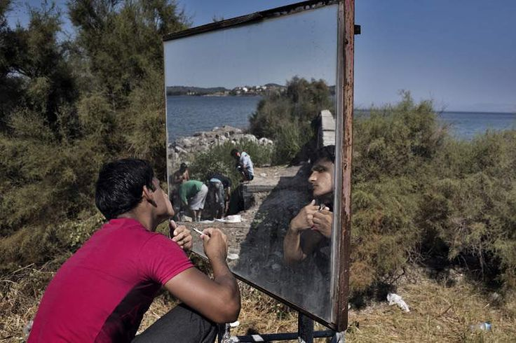 #TIMEDISPATCH An Afghan migrant shaves with the help of a traffic mirror on the side of a highway on the Greek island of Levos.  Photographer Yuri Kozyrev of @noorimages is on a three-week assignment for TIME documenting the refugee and migrant crisis across Europe. Read TIMEs Simon Shusters report on time.com/refugees and see more images on lightbox.time.com by time