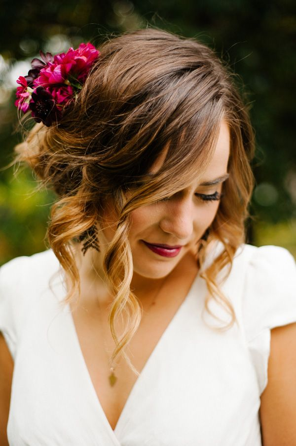 bride look with curled up do and berry colored lip #weddinghair #bride #weddingchicks http://www.weddingchicks.com/2014/03/13/intimate-earthy-wedding/
