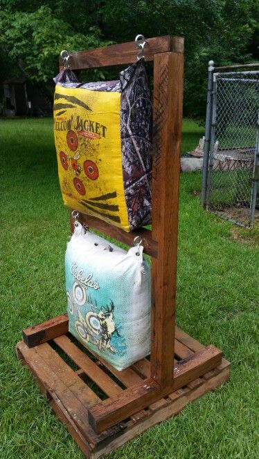 Target stand made from reclaimed timbers. Placed the stand on a pallet to keep it from sitting in the mud. The stand with bags weighs well over 20lbs, so don't have to mess with knocking the targets over anymore.